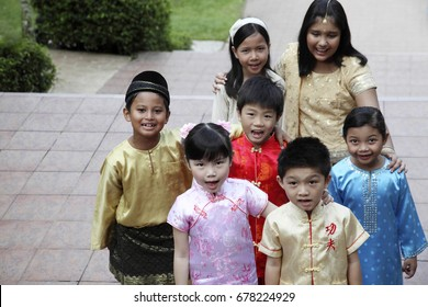 High angle view of multiracial kids in traditional costumes