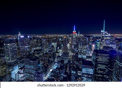 High angle view of the New York skyline at night, with all the illuminated skyscrapers.