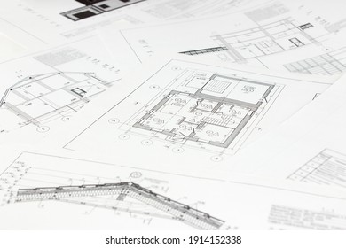 High angle view on architectural plans. Architectural design projects concept. Paper architectural drawings and blueprint