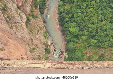 High angle view on the dramatic river gorge from the bridge; shot from directly above. Image filtered in faded, nostalgic, retro, Instagram style. Tara river gorge, Durmitor, Montenegro.