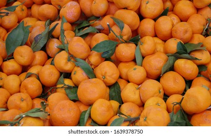 High angle view on large tray of satsuma mandarines on display for sale at a market stand