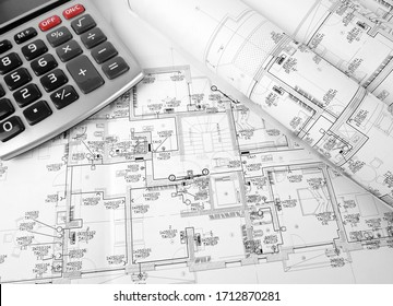 High angle view on the plan of electrical installation with calculator