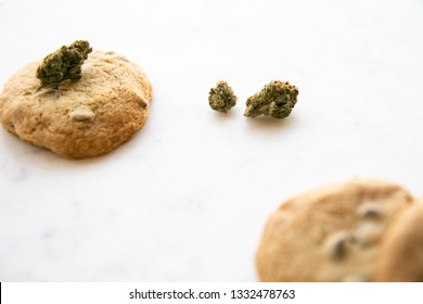 High Angle View on White Marble of Edible Marijuana Chocolate Chip Cookies and Buds
