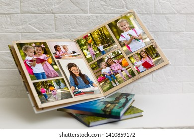 High angle view open book with album at home
