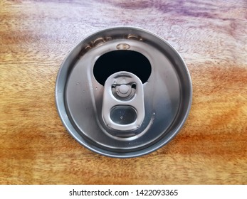 High Angle View of Open Soft Drink Can on Wooden Table
