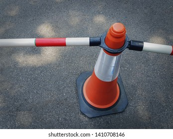 High Angle View of Orange Traffic Cone with Tubular Bars as Fence