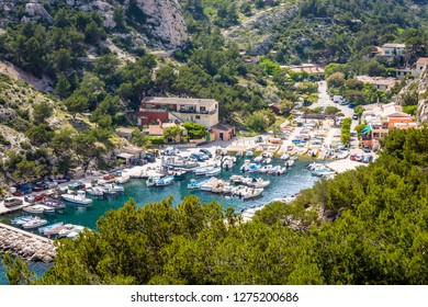 High angle view over the small fishing port in the calanque de Morgiou on the mediterranean shore, between Marseille and Cassis in the south of France, on a sunny spring day.