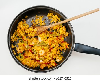 high angle view of paella in pan on table - ready to eat spanish food made from fresh ingredients in home conditions, home made organic lunch or dinner