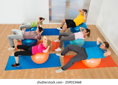High Angle View Of People Exercising On Pilate Ball