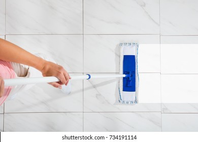 High Angle View Of Person Cleaning Floor With Mop