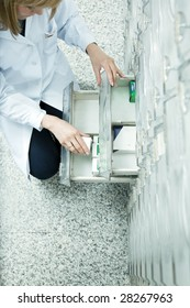 high angle view of pharmacist taking medicine from drawer. Copy space