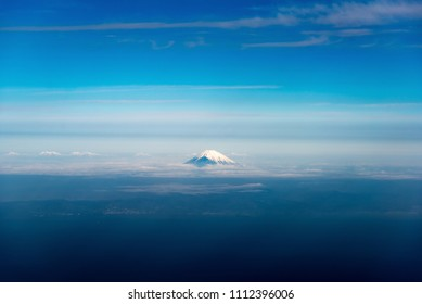 high angle View from plane to see Mountain Fuji and blue sky on morning time in Japan.