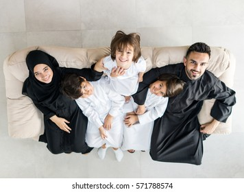 High angle view portrait of happy Arabic Muslim family at new modern home