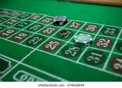 High angle view of ring and chips on roulette table at casino