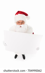 high angle view of santa holding blank card and looking at camera isolated on white