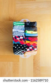 High angle view of socks neatly folded in a plastic container. Closeup, natural lighting, no retouch.