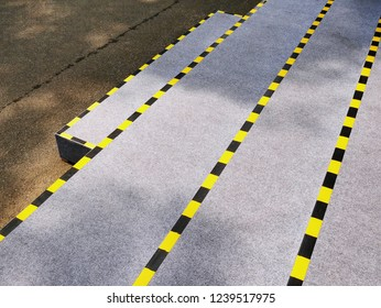 High Angle View of Stairs with Yellow and Black Striped Tapes for Safety Caution