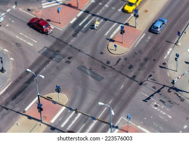 high angle view of a street intersection with cross walk markings, traffic signal lights - tilt shift