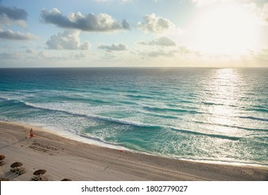 High angle view of a sunrise over the ocean and beach in Cancun Mexico