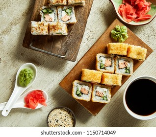 High angle view of sushi served with wasabi, ginger and soy sauce