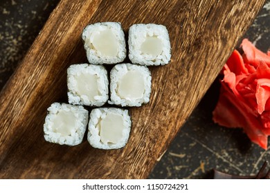 High angle view of sushi served on wooden plate