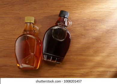 high angle view of syrup on wooden background