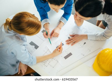 High angle view of team of architects working on construction project. Concept for teamwork, architecture, design, business, engineering