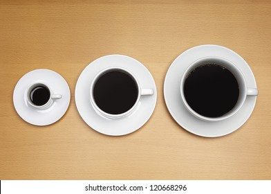High angle view of three coffee cups arranged according to their sizes
