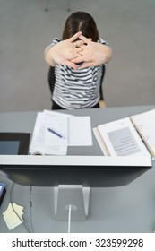 High Angle View of a Tired Office Woman Working on the Documents at her Desk, Stretching her Arms Up