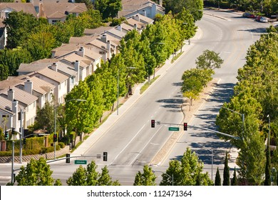 A high angle view of tract homes along a wide street in San Jose, California.