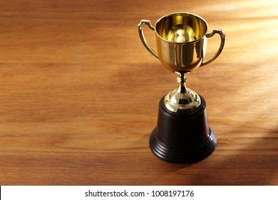 high angle view of trophy awrd on the wooden background