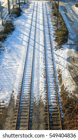 High angle view of two railway tracks sprinkled with a light dusting of snow/Duel Railway Tracks/High angle view of two railway tracks sprinkled with a light dusting of snow.