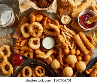 High angle view of variety of beer snack and one glass of beer