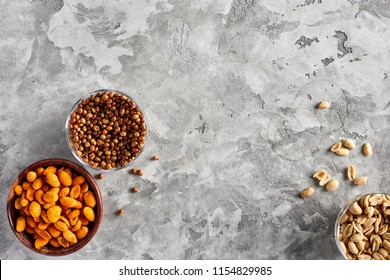 High angle view of variety of beer snacks on grey background. Copy space
