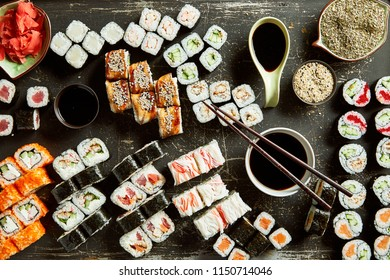 High angle view of variety of sushi server with sauces