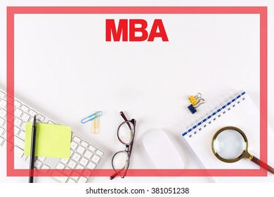 High Angle View of Various Office Supplies on Desk with a word MBA