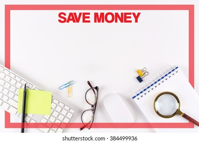 High Angle View of Various Office Supplies on Desk with a word SAVE MONEY