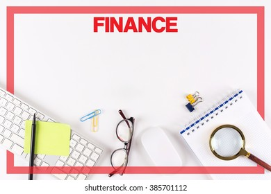 High Angle View of Various Office Supplies on Desk with a word FINANCE