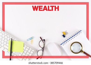 High Angle View of Various Office Supplies on Desk with a word WEALTH