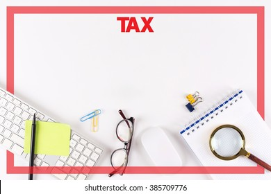 High Angle View of Various Office Supplies on Desk with a word TAX