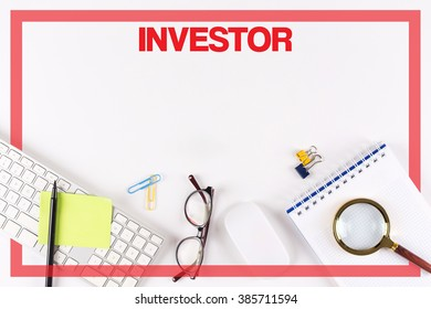 High Angle View of Various Office Supplies on Desk with a word INVESTOR