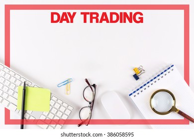 High Angle View of Various Office Supplies on Desk with a word DAY TRADING