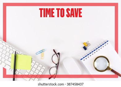 High angle view of various office supplies on desk with a word TIME TO SAVE