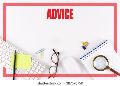 High angle view of various office supplies on desk with a word ADVICE
