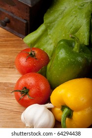 high angle view of vegetables and pepper grinder