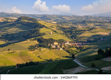 High angle view of the vineyard hills in the Langhe area of Piedmont, Unesco World Heritage Site since 2014, with the old village of Barolo, famous for its excellent namesake red wine, Piedmont, Italy