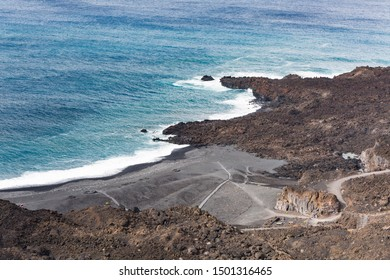 High angle view of volcanic lava coastline with the beach Playa Echentive in the south of La Palma, Spain.