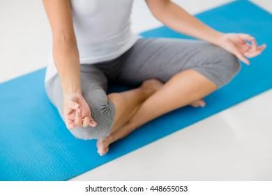 High angle view of woman doing yoga at fitness studio