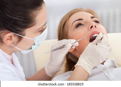 High Angle View Of A Woman Having Her Dental Checkup