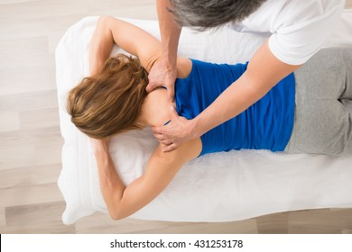 High Angle View Of Woman Receiving Body Massage At Spa